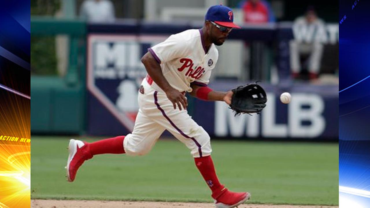 Philadelphia Phillies Jimmy Rollins fields a hit by St. Louis Cardinals Tony Cruz in the ninth inning of a baseball game Sunday, Aug. 24, 2014.