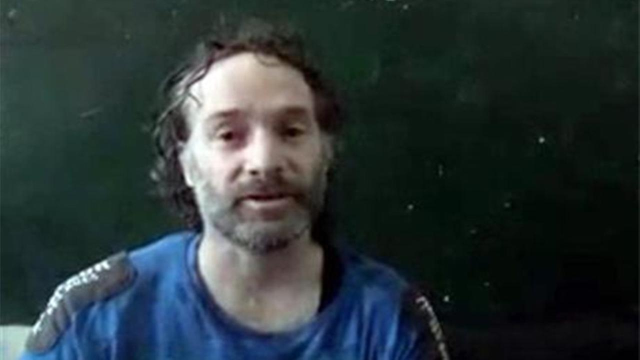 This image made from undated video obtained by The Associated Press, shows a man believed to be Peter Theo Curtis, a U.S. citizen held hostage by an al-Qaida linked group in Syria.