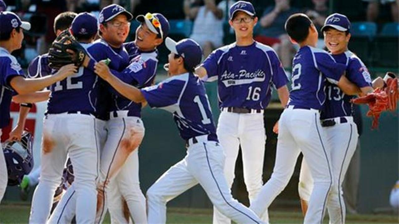 South Korea celebrates an 8-4 win over Chicago in the Little League World Series championship baseball game in South Williamsport, Pa., Sunday, Aug. 24, 2014