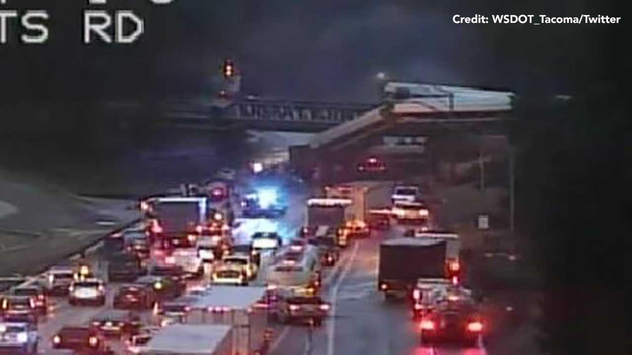 A traffic camera captured this image of train cars hanging off an overpass after a derailment in Washington state.