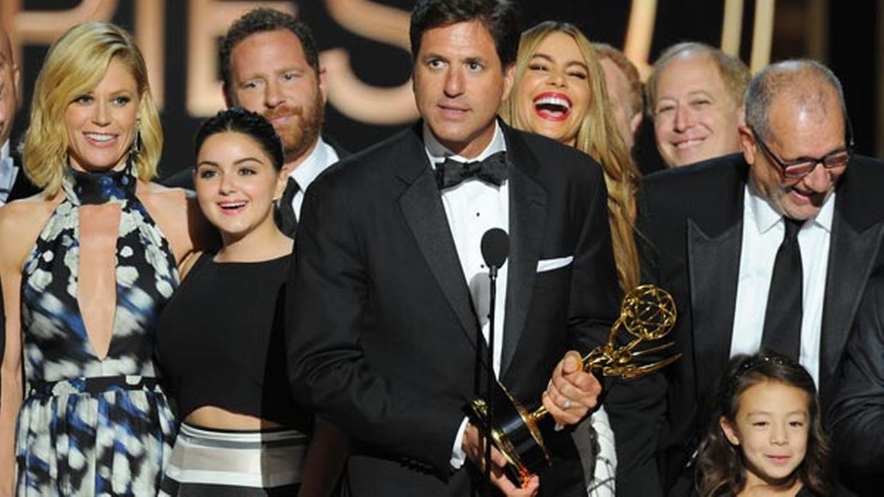 Steven Levitan, center, and the cast and producers of Modern Family accept the award for outstanding comedy series at the 66th Primetime Emmy Awards at the Nokia Theatre L.A.