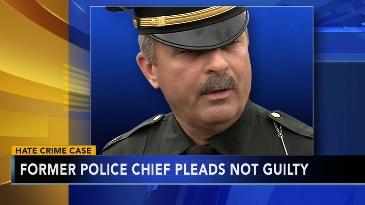 Ex-police chief accused of hate crime pleads not guilty
