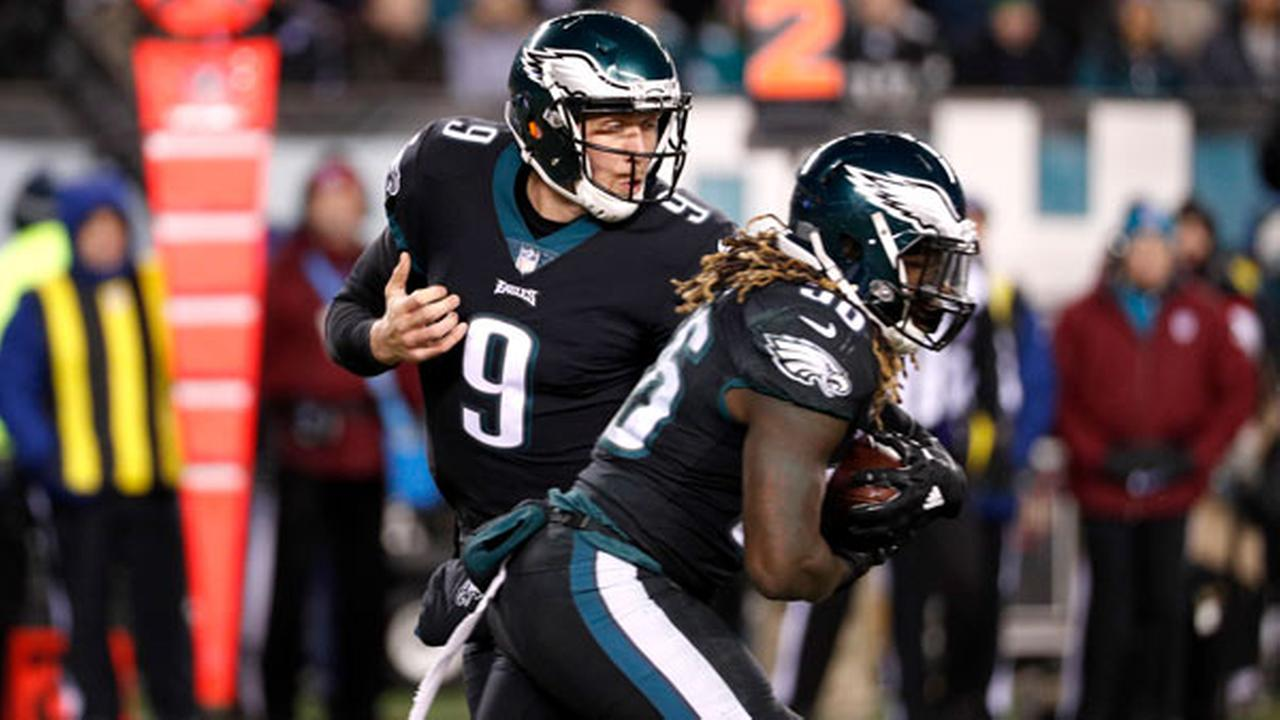 Philadelphia Eagles Nick Foles, left, hands off to Jay Ajayi during the first half of an NFL football game against the Oakland Raiders, Monday, Dec. 25, 2017, in Philadelphia.