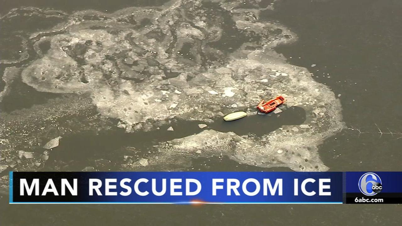 Person rescuing swan pulled from icy Bucks Co. pond