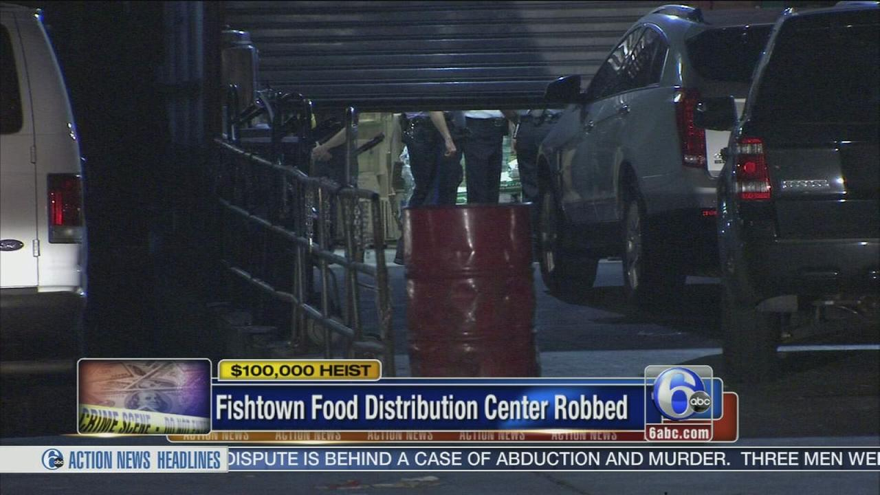 VIDEO: Fake cops rob food distribution center