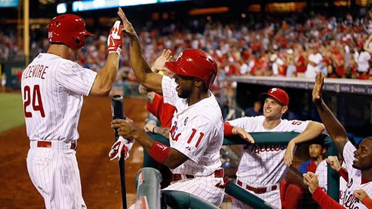 Grady Sizemore celebrates with Jimmy Rollins after Sizemores two-run home run during the sixth inning of a baseball game against the Washington Nationals, Wednesday, Aug. 27, 2014