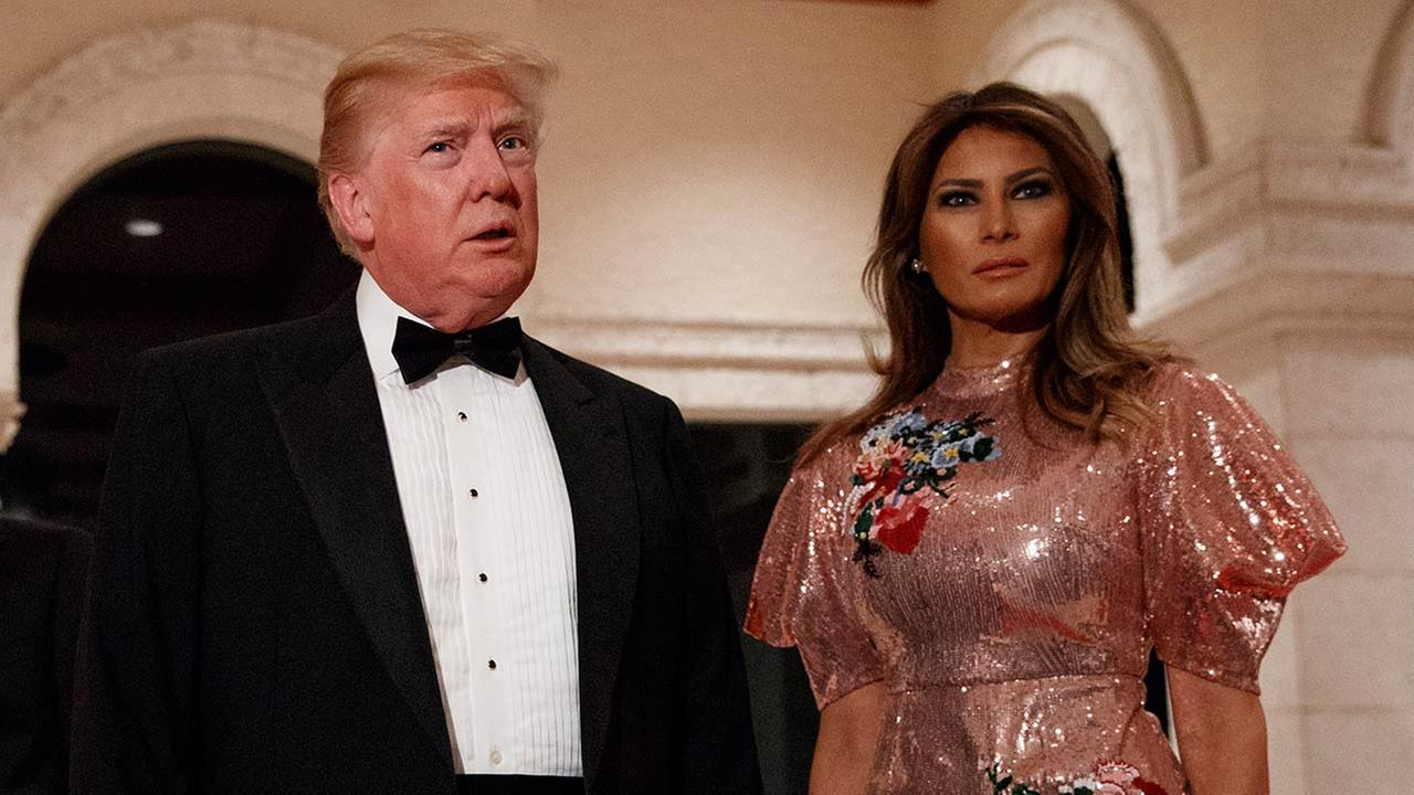 President Trump speaks with reporters as he arrives for a New Years Eve gala at his Mar-a-Lago resort with first lady Melania Trump, Sunday, Dec. 31, 2017 (AP Photo/Evan Vucci)
