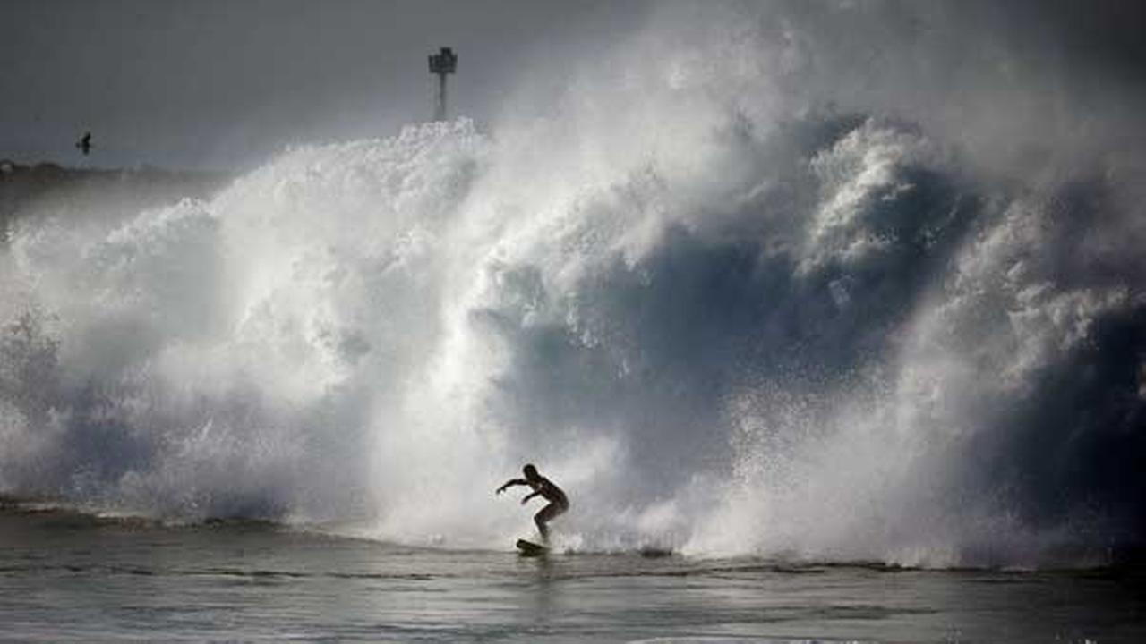 A surfer rides a wave at the wedge in Newport Beach, Calif., Wednesday, Aug. 27, 2014.