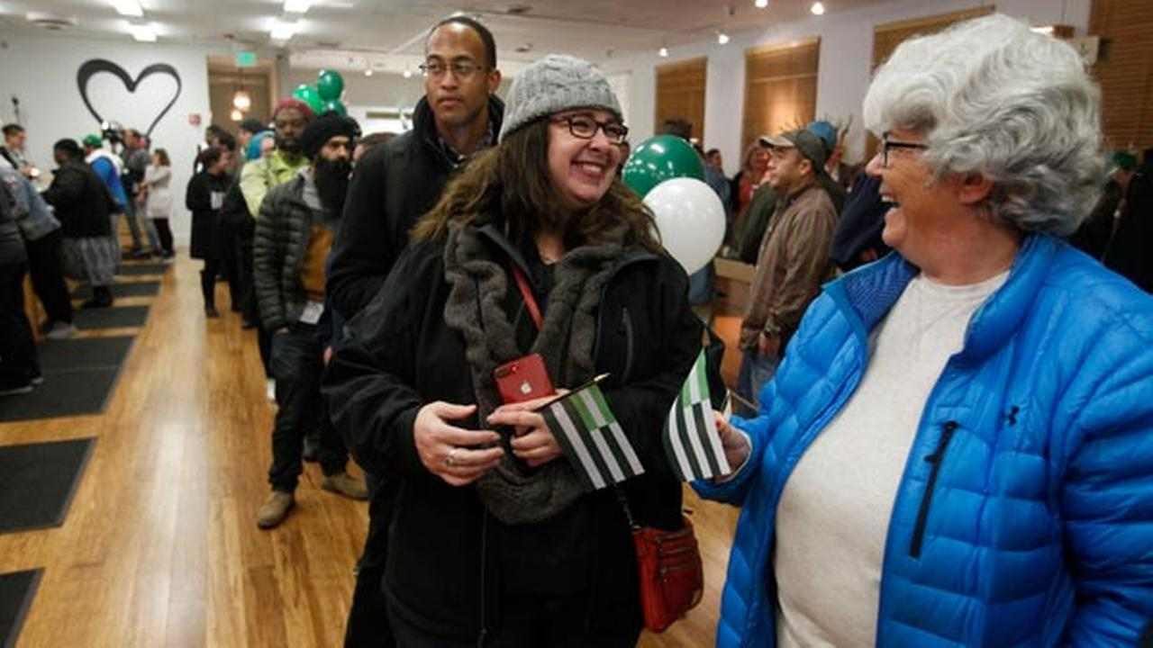 Margot Simpson, right, and Diana Gladden wait in line to purchase marijuana at Harborside marijuana dispensary, Monday, Jan. 1, 2018, in Oakland, Calif.