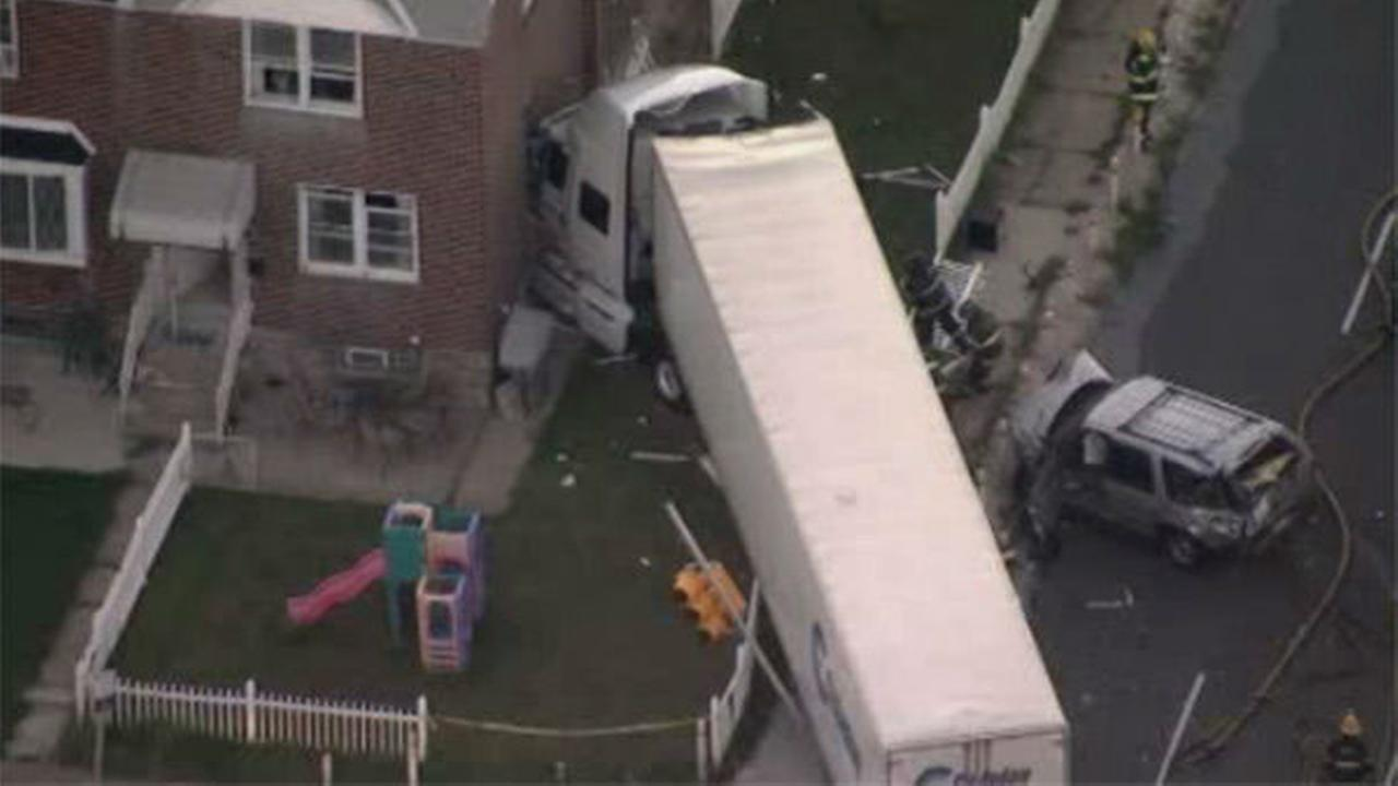 PHOTOS: Tractor-trailer slams into Mayfair home