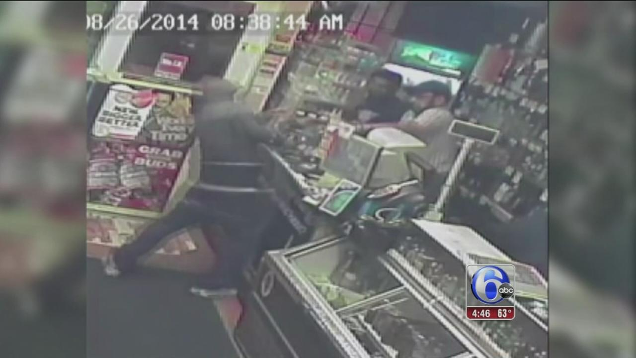 VIDEO: Liquor store owner fights off would-be robbers