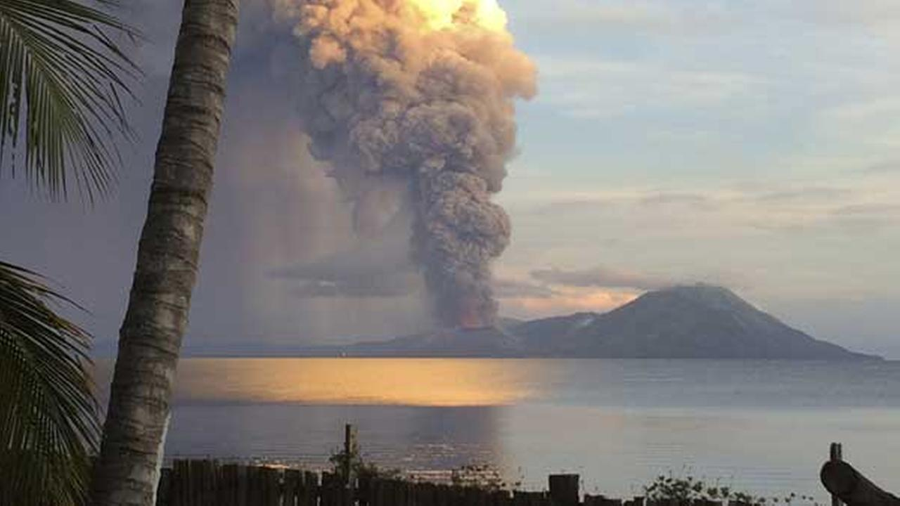 In this photo taken and released by Jason Tassell, a huge smoke billows from Mt. Tavurvu after an eruption in Kokopo, east New Britain, Papua New Guinea, Friday, Aug. 29, 2014.