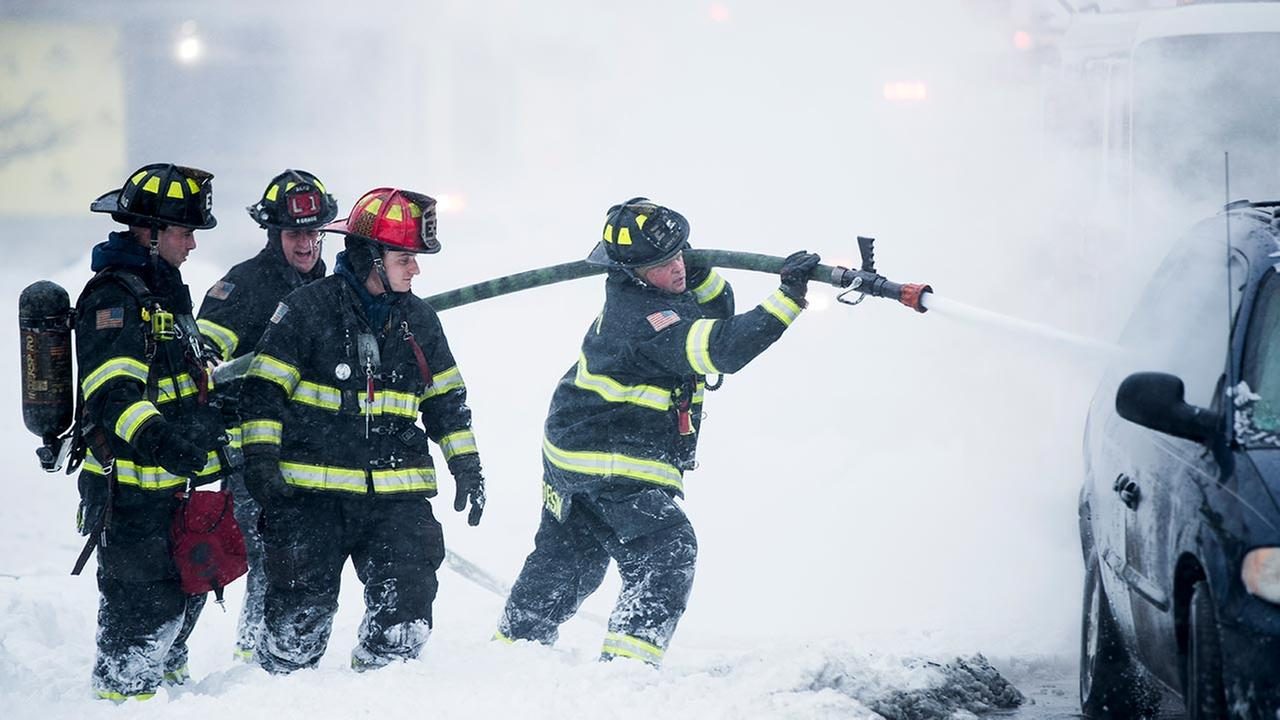 Firefighters extinguish a vehicle fire during a winter snowstorm in Atlantic City, N.J., Thursday, Jan. 4, 2018. (AP Photo/Matt Rourke)