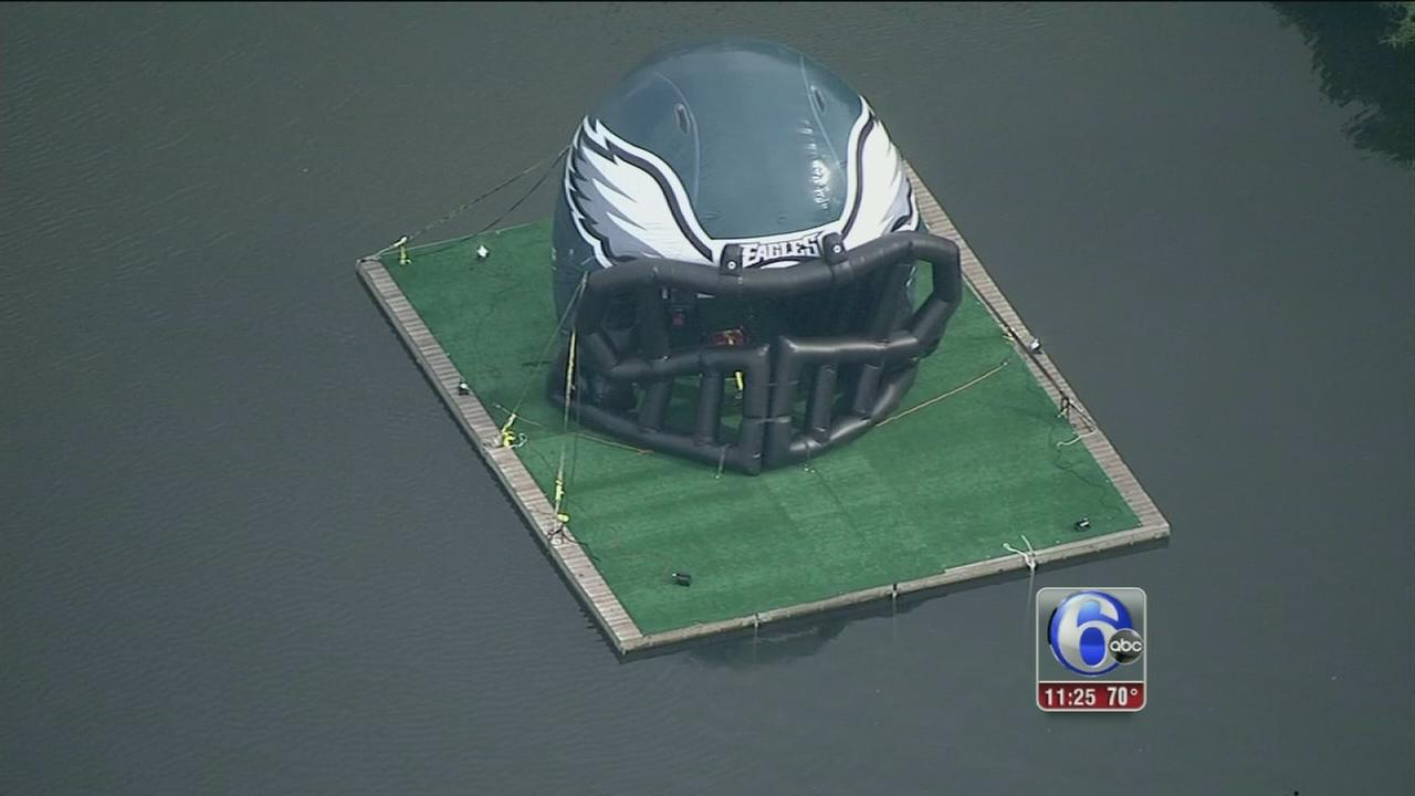 VIDEO: Large inflatable Eagles helmet floats down Schuylkill River