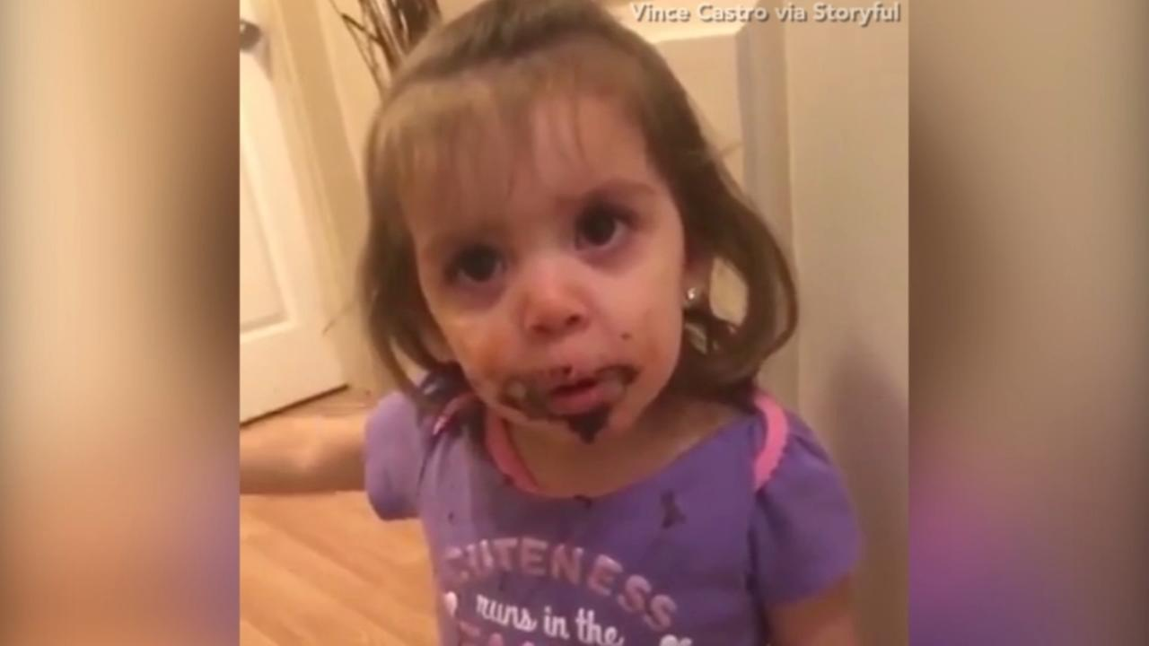Adorable little girl has had one too many cookies