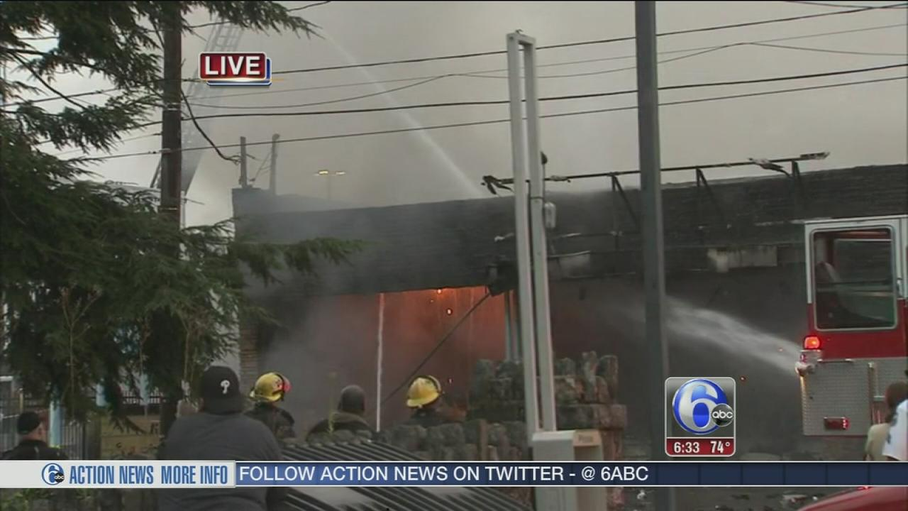 VIDEO: Flames  damage dry cleaners in Roxborough