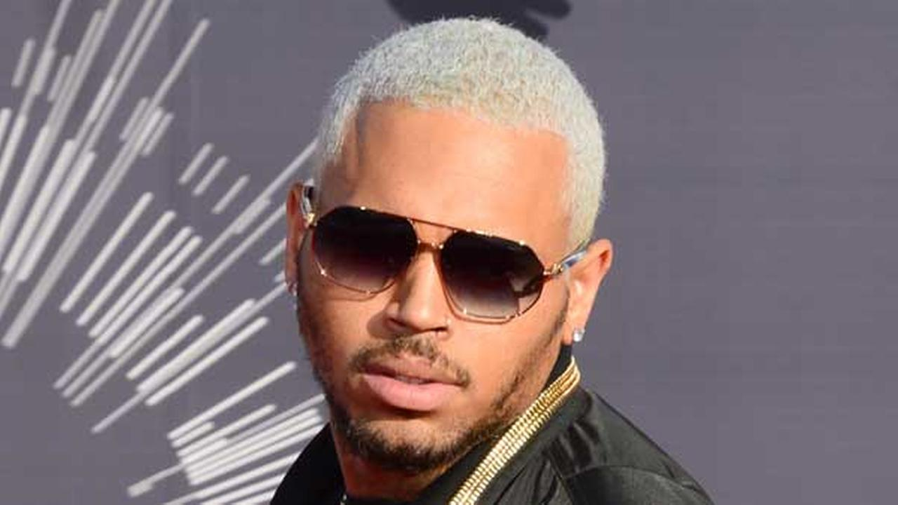 Chris Brown arrives at the MTV Video Music Awards at The Forum on Sunday, Aug. 24, 2014, in Inglewood, Calif. (Photo by Jordan Strauss/Invision/AP)