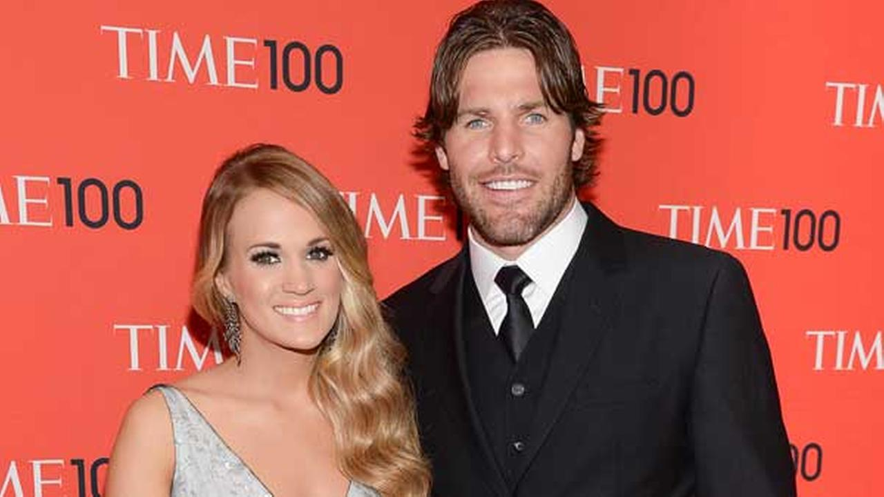 Singer Carrie Underwood and husband Mike Fisher arrive at the 2014 TIME 100 Gala held at Frederick P. Rose Hall, Jazz at Lincoln Center on Tuesday, April 29, 2014 in New York.