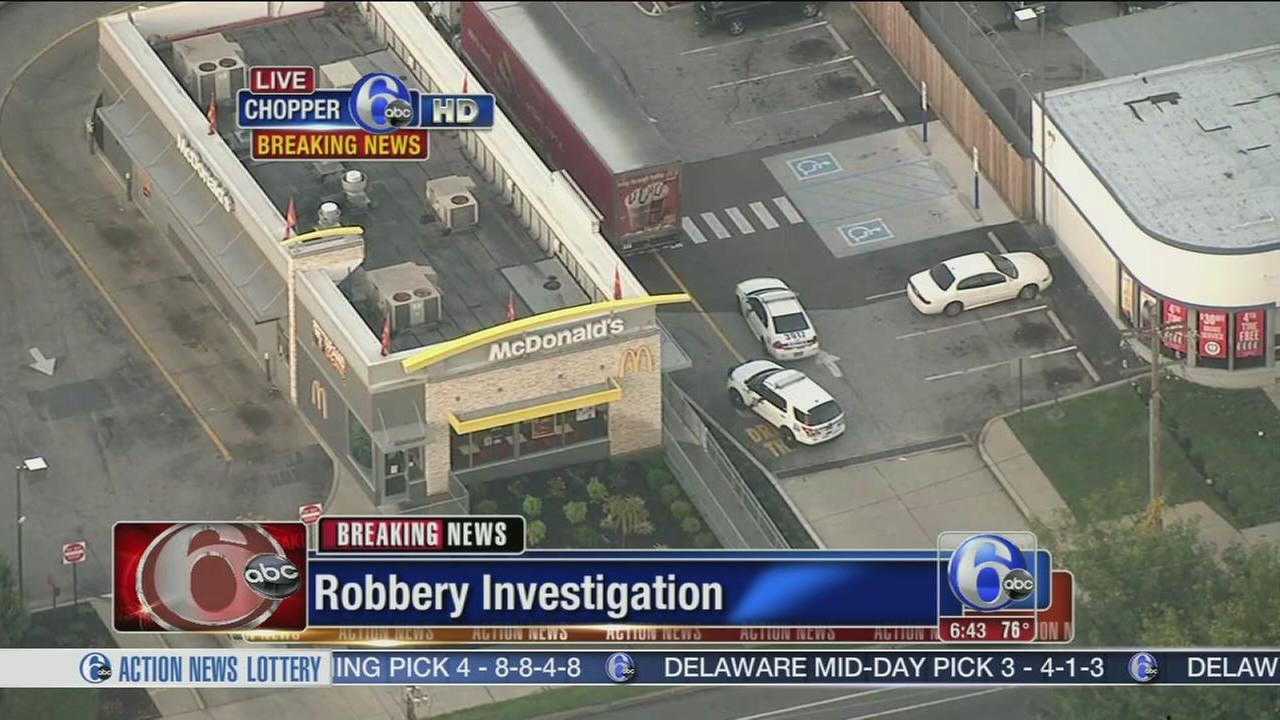 VIDEO: McDonalds robber escapes in a cab