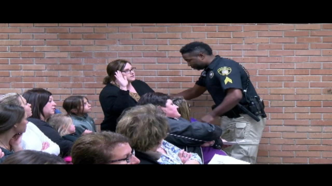 Teacher is handcuffed by officer at school board meeting