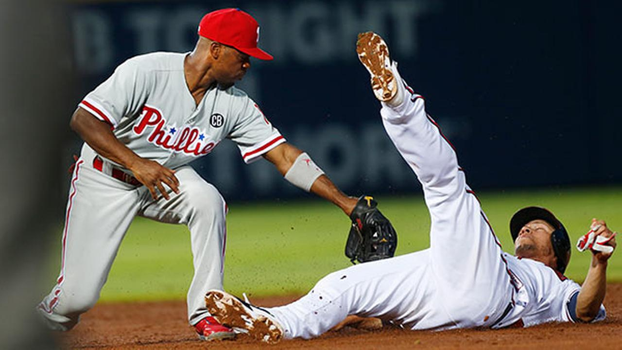 Atlanta Braves Andrelton Simmons (19) is out at second attempting to steal as Philadelphia Phillies shortstop Jimmy Rollins applies the tag in the third inning of a baseball game.