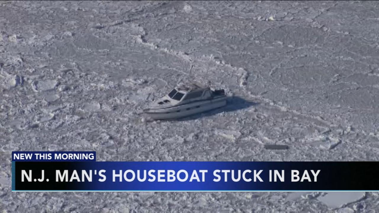 NJ mans houseboat stuck in bay