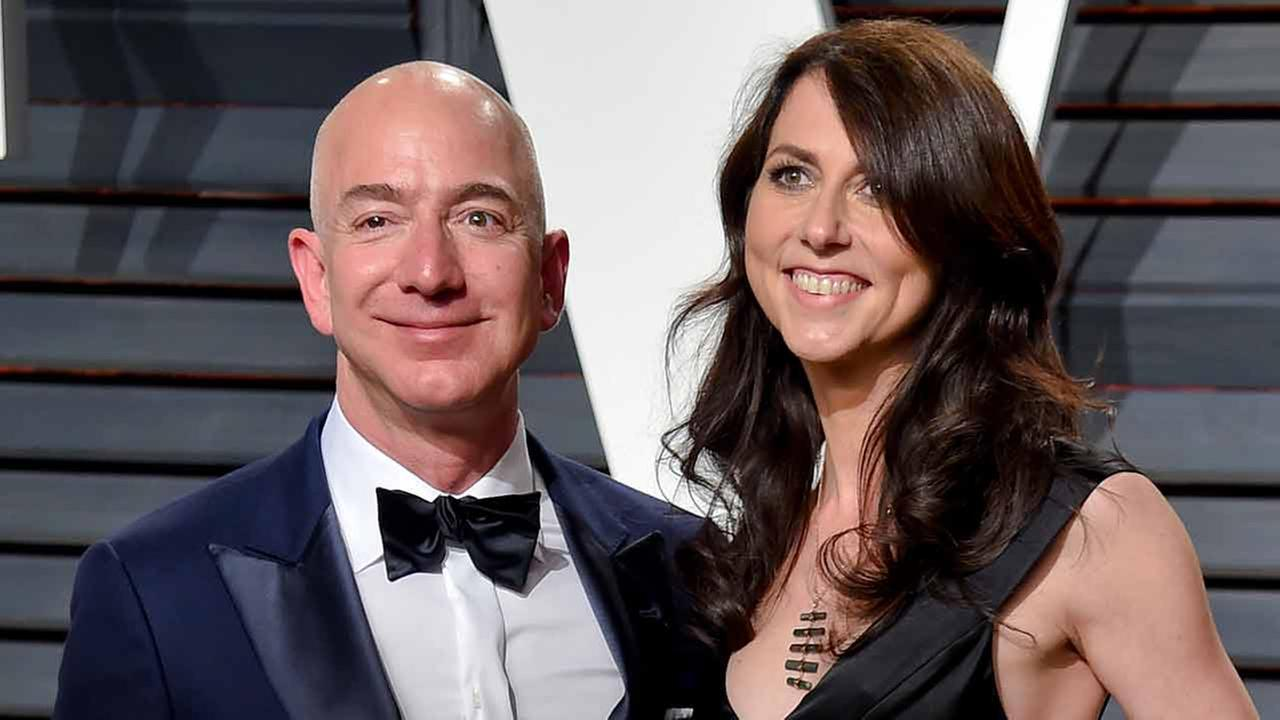 Amazon CEO Jeff Bezos, left, and wife MacKenzie Bezos arrive at the Vanity Fair Oscar Party on Monday, Feb. 27, 2017, in Beverly Hills, Calif.