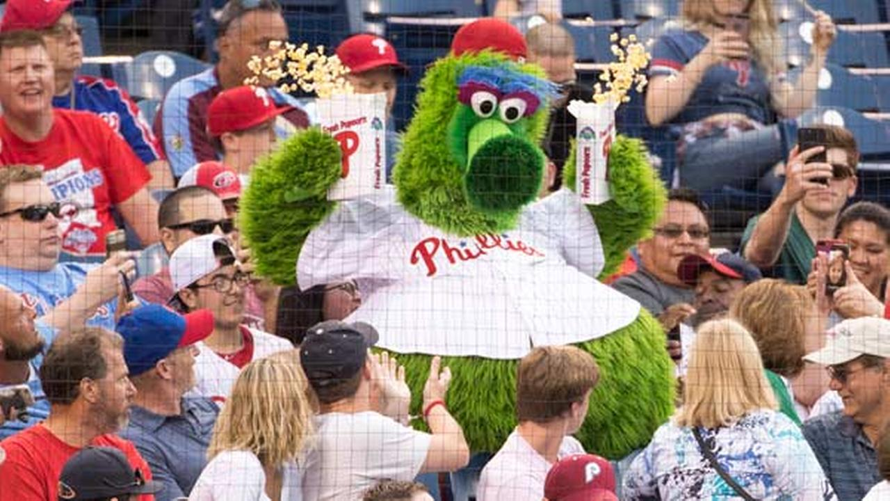 The Phillie Phanatic tries to get to a set as he spills popcorn on the fans during the third inning of a game between the Diamondbacks and the Phillies, Friday, June 16, 2017.