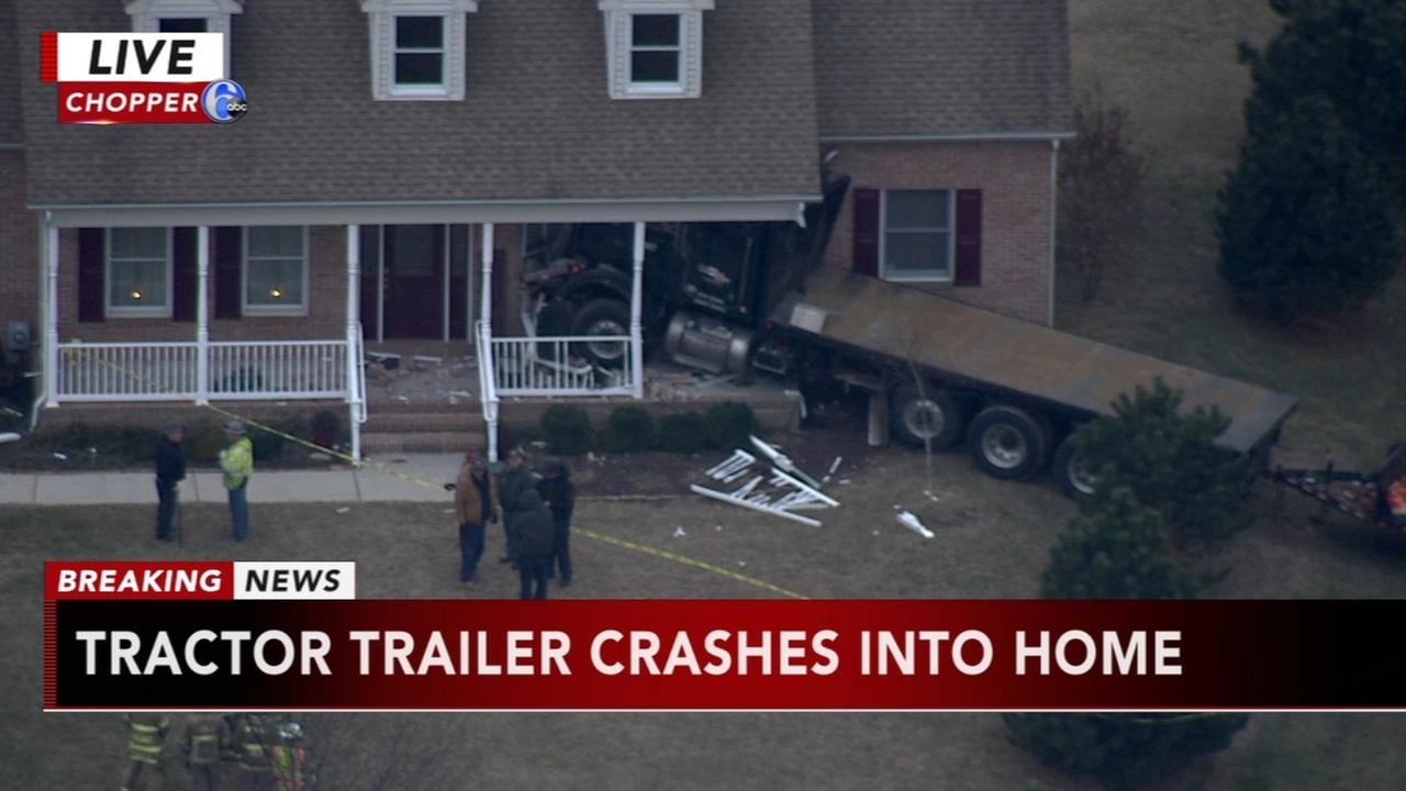 Large flatbed truck crashes into Salem Co. home