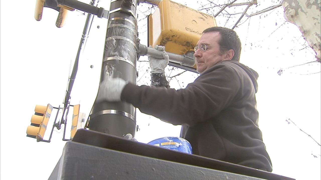 Philadelphia police grease poles to disuade climbers