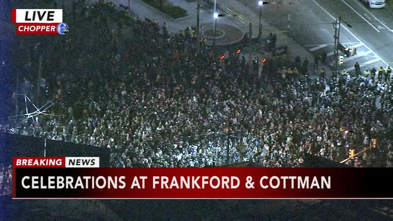 Fans celbrating the Eagles win at Frankford and Cottman avenues