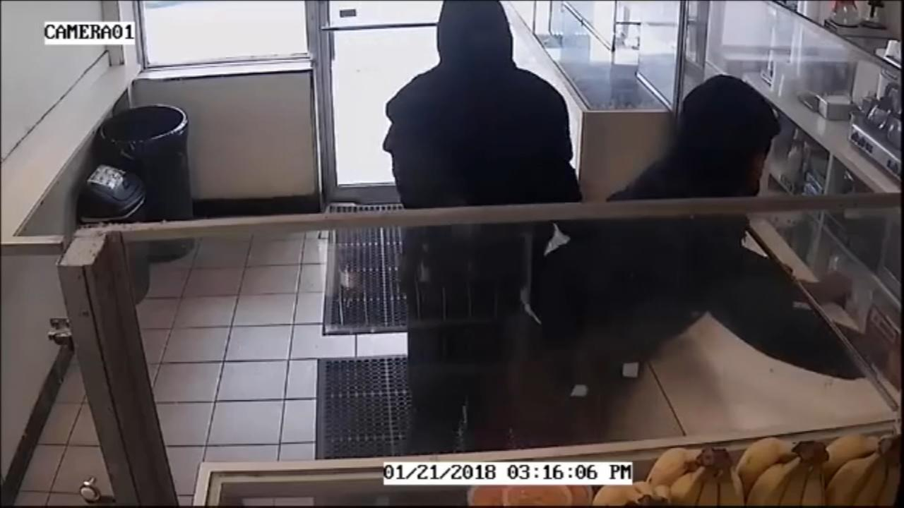 Surveillance video captures suspects in donut shop robbery