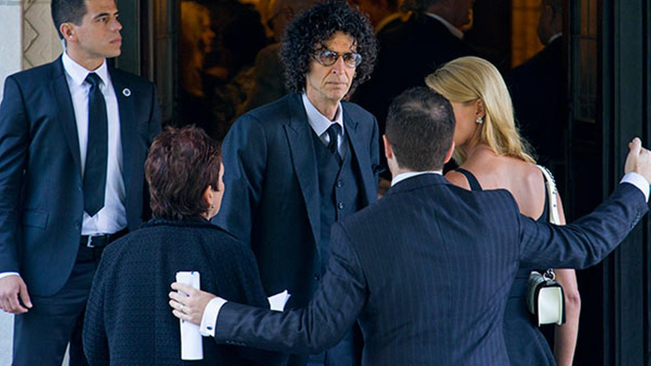Howard Stern, center, arrives at a funeral service for comedian Joan Rivers at Temple Emanu-El in New York, Sunday, Sept. 7, 2014. Rivers died Thursday, Sept. 4, 2014. She was 81.