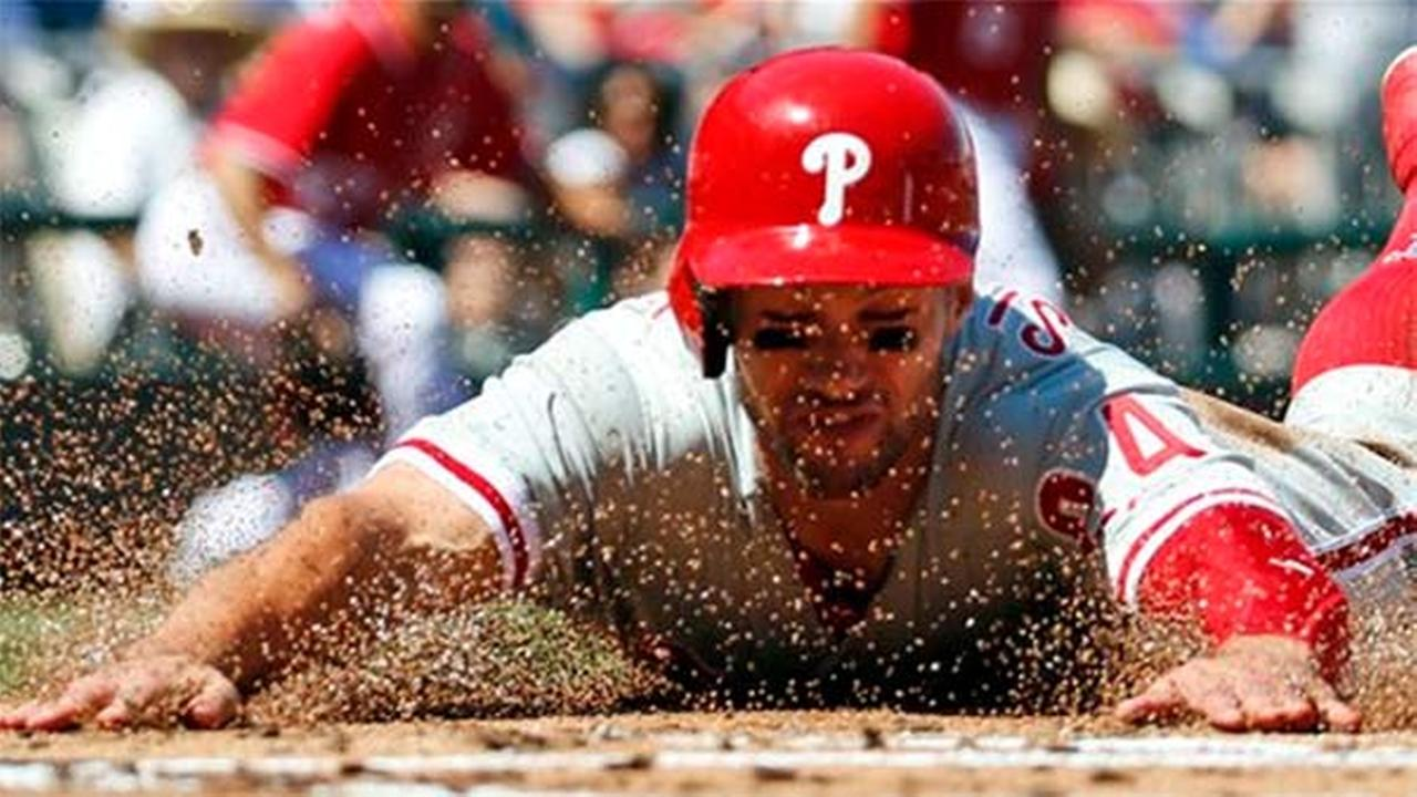 Philadelphia Phillies left fielder Grady Sizemore slides safely into home in a game against the Washington Nationals, Sunday, Sept. 7, 2014..