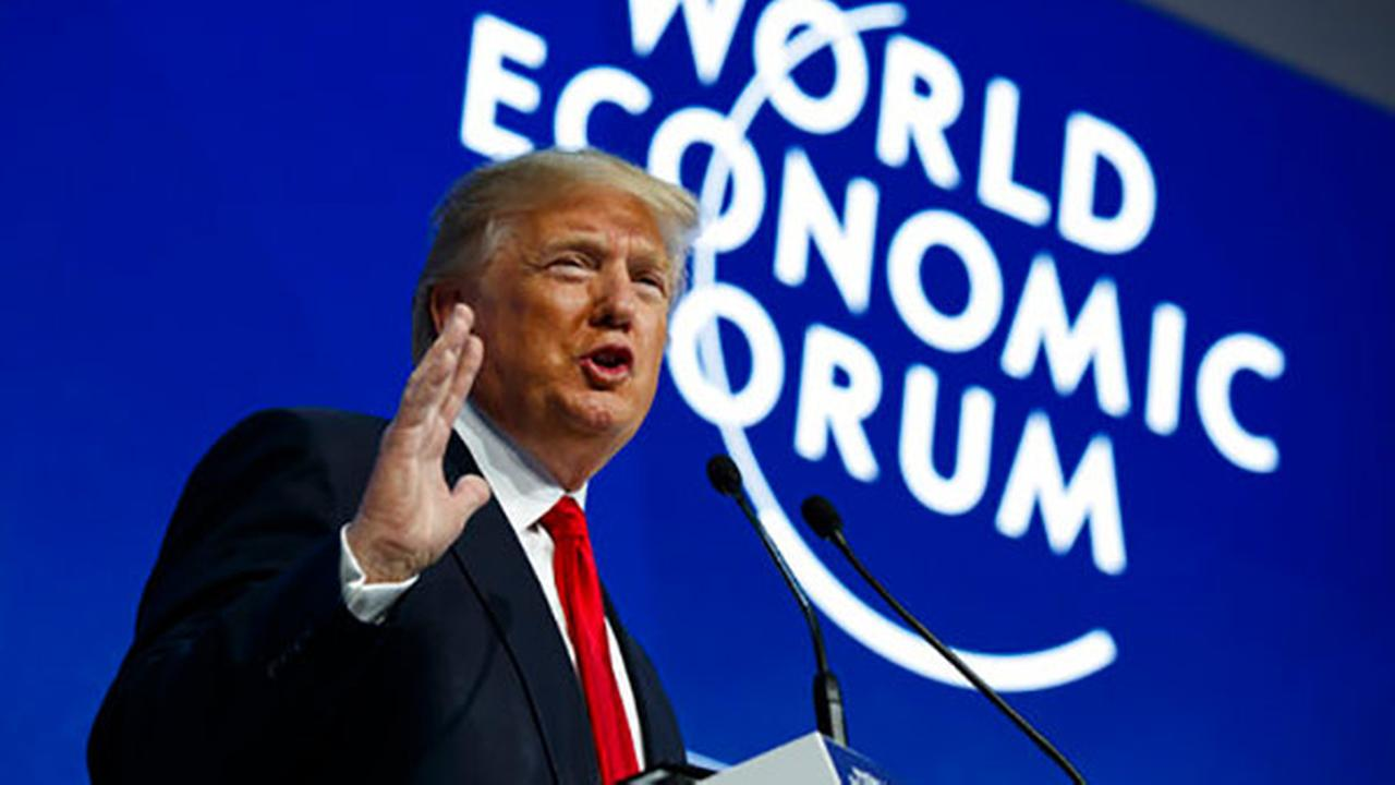 Davos: Trump launches attack on 'predatory' trade