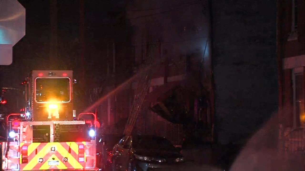 Fire crews battle house fire in North Philadelphia