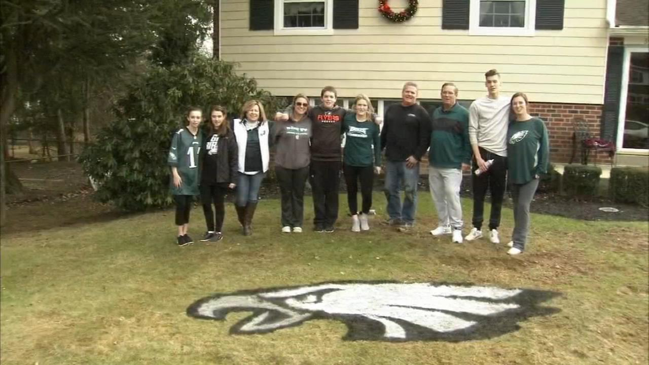 Delco man paintings logos on lawns
