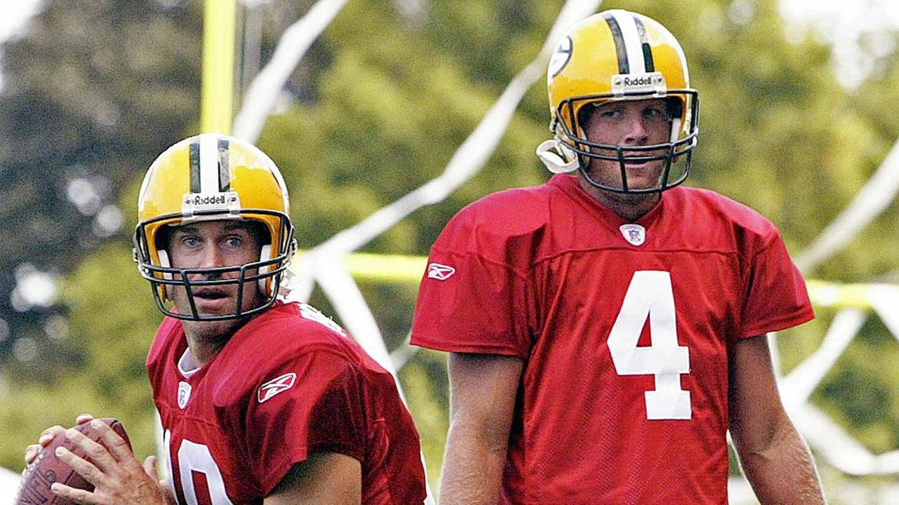 Green Bay Packers quarterback Brett Favre watches Doug Pederson (18) drop back for a pass at training camp, Wednesday, Aug. 4, 2004, in Green Bay, Wis. (AP Photo/Morry Gash)