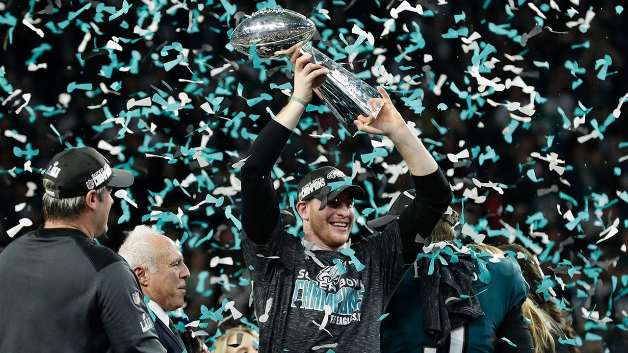 Philadelphia Eagles Nick Foles holds up the Vince Lombardi Trophy after the NFL Super Bowl 52 football game against the New England Patriots, Sunday, Feb. 4, 2018, in Minneapolis.