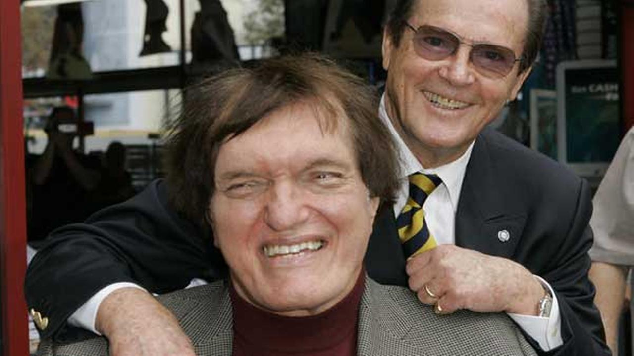 FILE - In this Oct. 11, 2007 file photo, actor Roger Moore, right, poses with actor Richard Kiel in Los Angeles.
