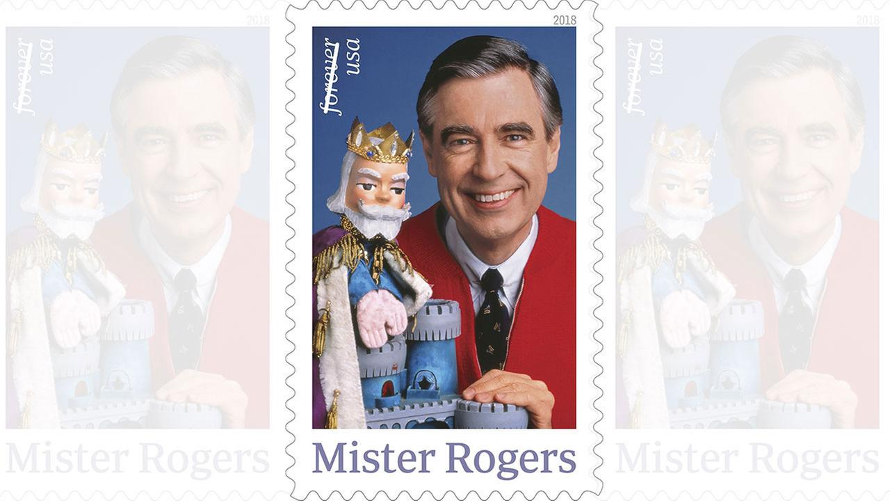This image shows a postage stamp featuring Fred Rogers from the PBS childrens television series Mister Rogers Neighborhood with his King Friday XIII puppet.