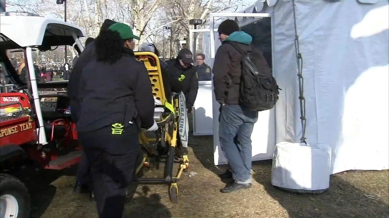 Medical staff treats injuries inside tents at parade