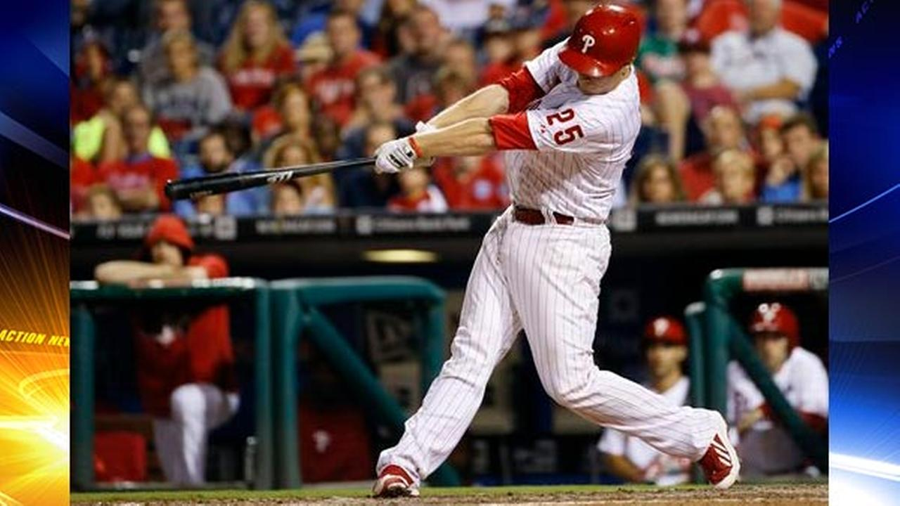 Philadelphia Phillies Cody Asche follows through after hitting the game-winning two-run home run vs. the Miami Marlins, Friday, Sept. 12, 2014.