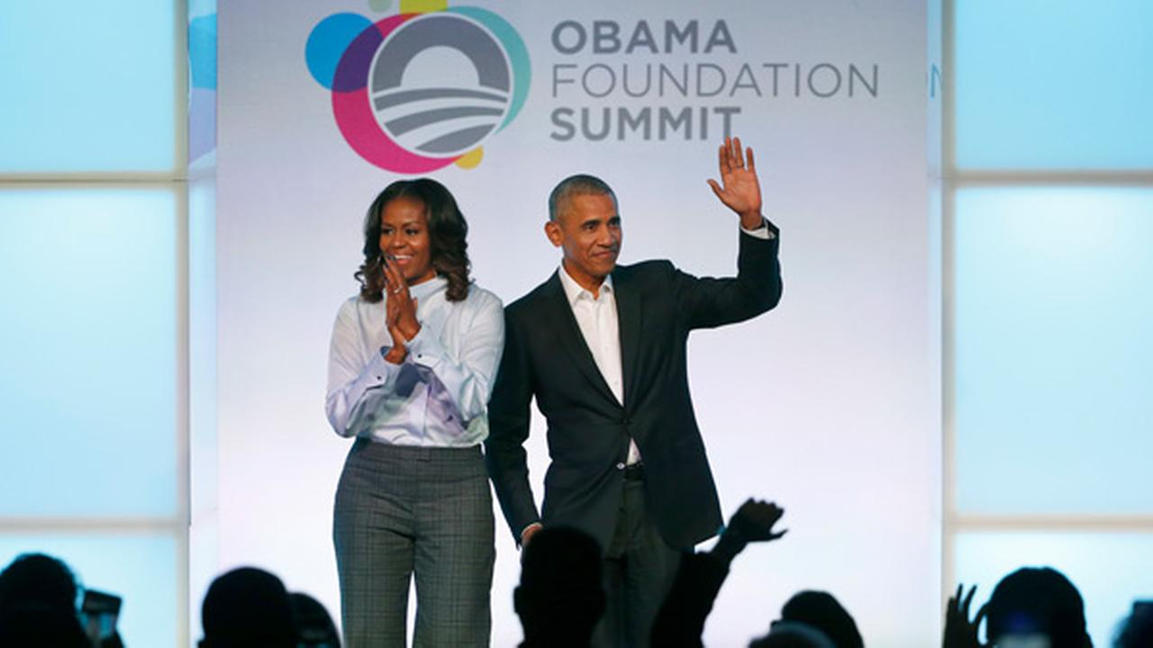 Former President Barack Obama, right, and former first lady Michelle Obama arrive for the first session of the Obama Foundation Summit Tuesday, Oct. 31, 2017, in Chicago.