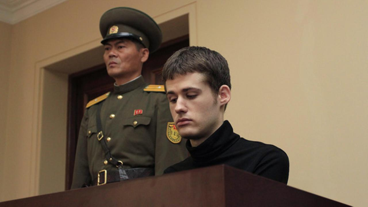 Matthew Miller, a U.S. citizen, sits on the dock at the Supreme Court during his trial in Pyongyang, North Korea, Sunday, Sept. 14, 2014.