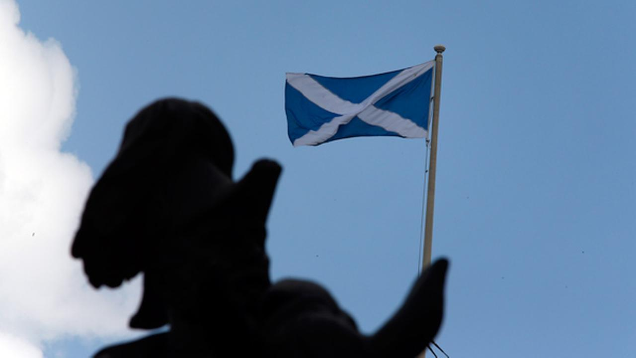 The Scottish flag flies on a government building at Whitehall in central London, Wednesday, Sept. 10, 2014.