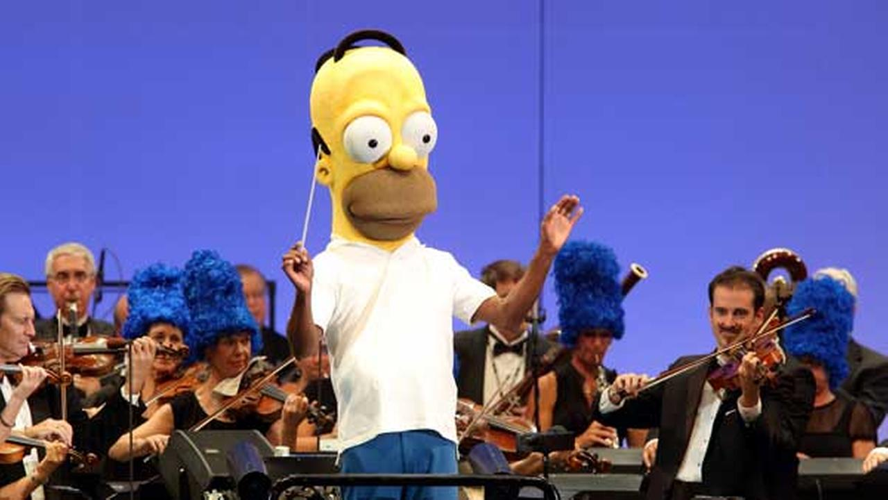 Conductor Thomas Wilkins performs at the world premiere of The Simpsons Take the Bowl at the legendary concert venue Friday, Sept. 12, 2014, in Los Angeles.