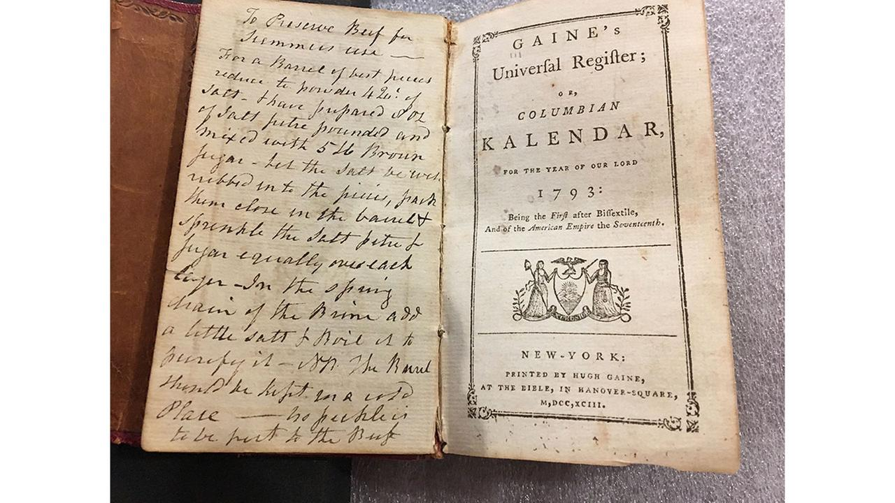 In this Feb. 14, 2018 photo, an old almanac that contained a lock of George Washingtons hair lay open on a table at Union College in Schenectady, N.Y.