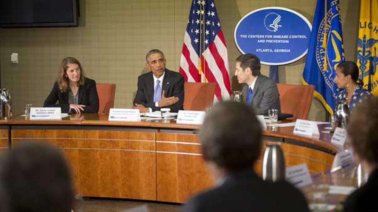 President Barack Obama, center, during a briefing at the Centers for Disease Control and Prevention (CDC) in Atlanta, Tuesday, Sept. 16, 2014.