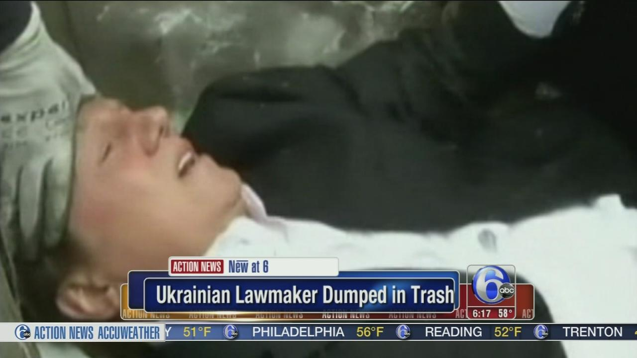 VIDEO: Ukranian lawmaker dumped in trash